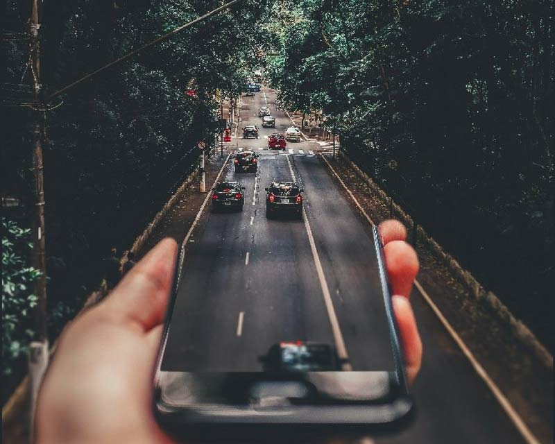 Abstract image of a mobile device and a local highway