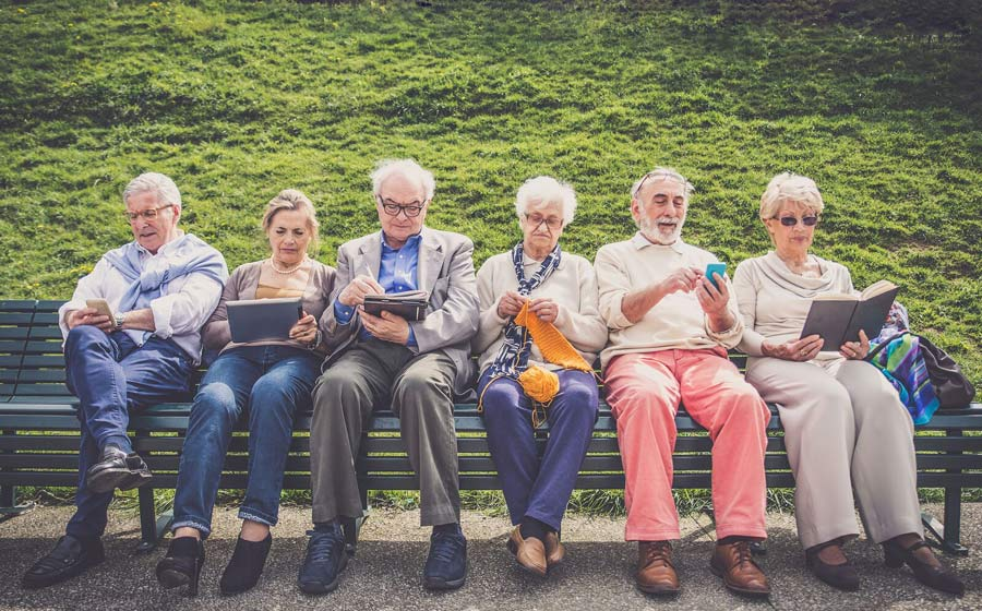 Senior citizens using digital devices